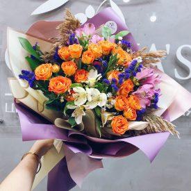 Завораживающий букет с оранжевыми розами
